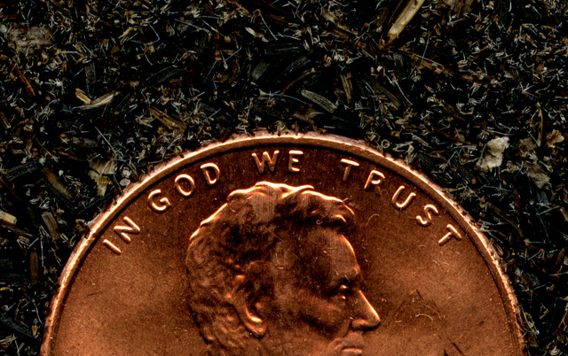 The Penny says In God we Trust